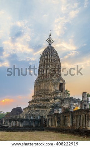 The beautiful sunset in park of Buddha at the old statues at Wat Praprang ancient capital of Sukhothai, Thailand. Sukhothai Historical Park is the UNESCO world heritage - stock photo