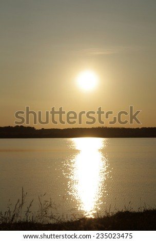 The Beautiful sunset on the lake - stock photo