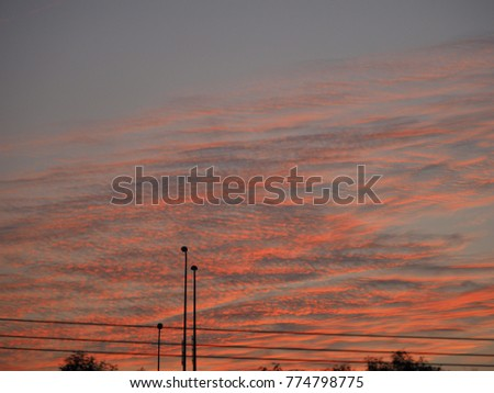 The beautiful sunset sky with the blue sky and clouds in summer