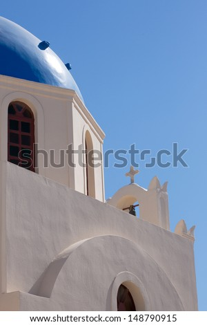 The beautiful 18th century church and its distinctive blue domed bell tower is the symbol of the Island of Santorini.Agiou Mina.Church. Santorini, Greece, 2013.