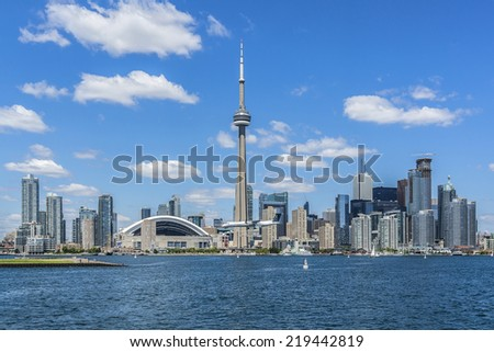The beautiful Toronto's skyline with CN Tower over lake. Urban architecture. Canada. - stock photo