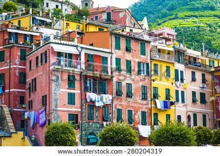 The beautiful town of Vernazza with its colorful buildings and green mountains as a backdrop, Liguria, Italy, Europe