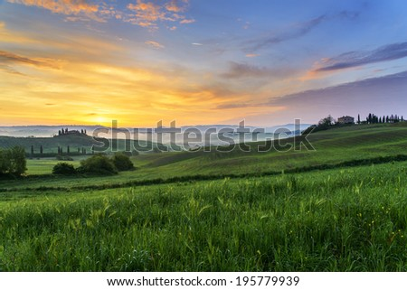 The beautiful tuscan countryside at sunrise