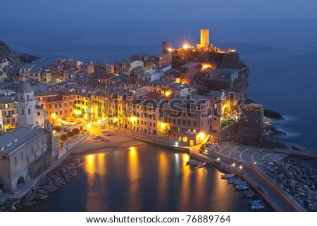 The beautiful Vernazza fishing village in Italy by night - stock photo