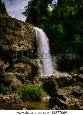 The beautiful waterfall in forest at summer - stock photo