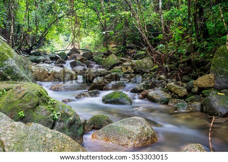 The beautiful waterfall in forest, spring, long exposure - stock photo