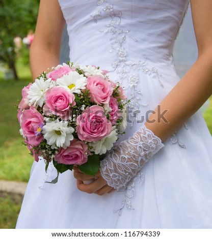 The beautiful wedding bouquet flowers in bride's hands