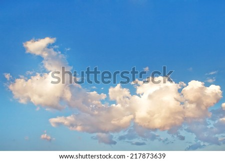 The beautiful white clouds and blue sky background. - stock photo
