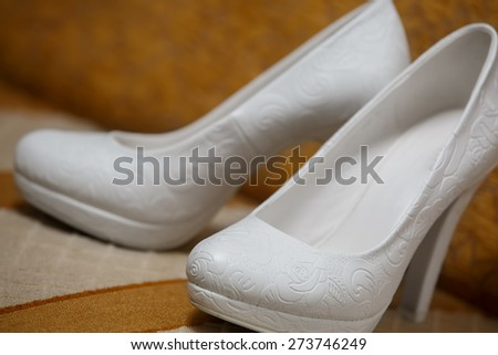 the beautiful white wedding Shoes of bride