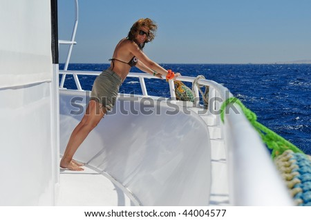The beautiful woman has a rest on the yacht - stock photo