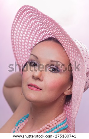 The beautiful woman in a pink hat