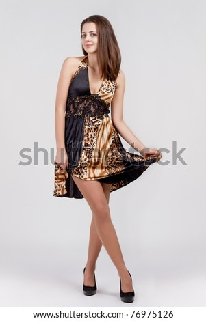 The beautiful woman in dress - stock photo
