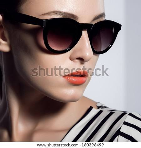The beautiful woman in sunglasses - stock photo