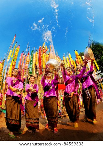 The beautiful woman thai people celebrate Songkran festival (water festival) in Chiangmai, Thailand on April 13, 2010. - stock photo