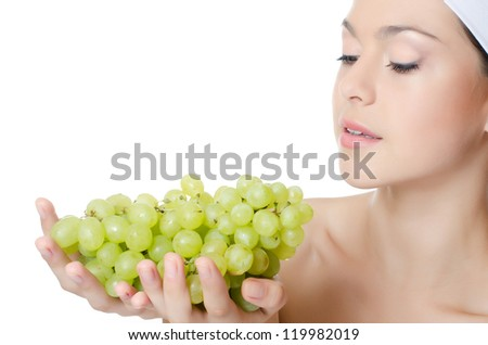 The beautiful woman with a grapes isolated