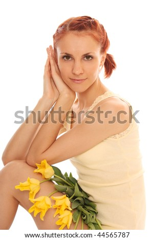 The beautiful woman with bouquet of yellow tulips