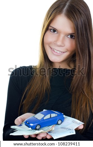 The beautiful woman with money and toy car in hands - stock photo