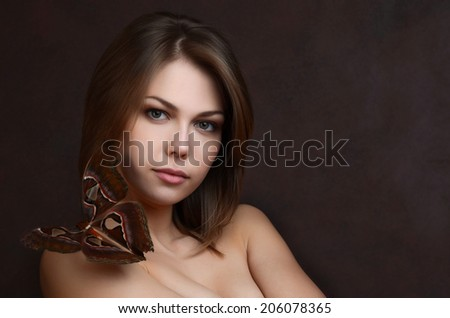 The beautiful woman with the tropical butterfly - stock photo