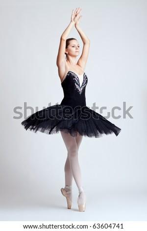 The beautiful young dancer. The ballerina posing. - stock photo