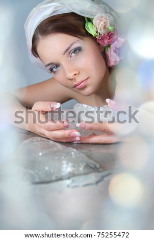 The beautiful young girl in a role of spring which heats winter ice - stock photo
