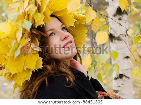 The beautiful young girl in autumn park