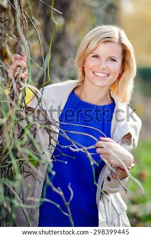 The beautiful young girl. Woman in autumn. - stock photo
