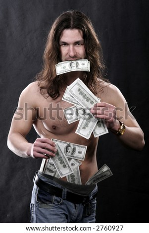 The beautiful young man with set of dollars