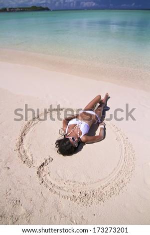 the beautiful young sexy girl in bikini on a beach - stock photo