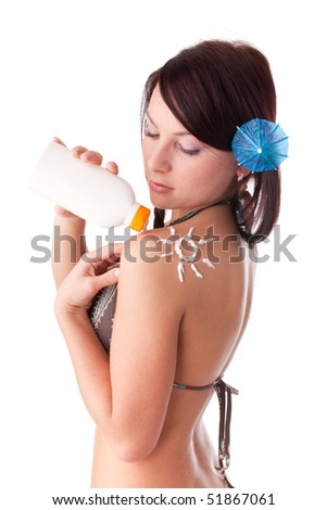The beautiful young woman in bikini with the drawn sun on a shoulder on a white background. - stock photo