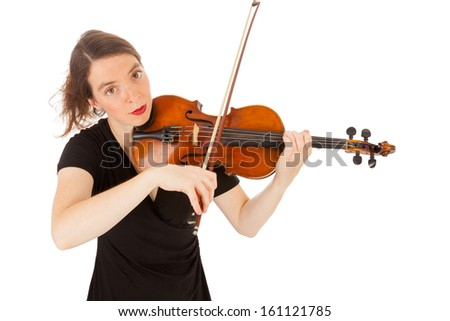 The beautiful young woman is playing the violin - stock photo