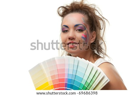 The beautiful young woman with a color guide on a white background. Designer of interior. - stock photo
