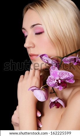 The beautiful young woman with flowers orchid