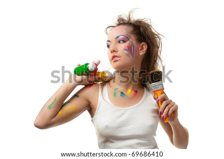 The beautiful young woman with  paints and paintbrushes on a white background. Designer of interior. - stock photo