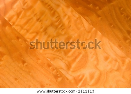 The beautifully grained tiger maple wood on my hand crafted rocking chair. - stock photo