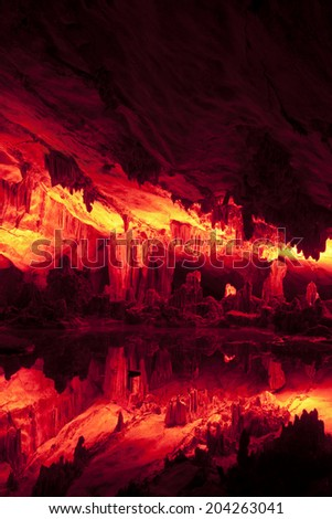 "The beautifully illuminated Reed Flute Caves displaying the ""Crystal Palace of the Dragon King"" formations. Located in Guilin, Guangxi Provine, China - stock photo"