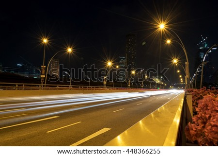 The beauty of car lights and street lighting at night on the road in the city.