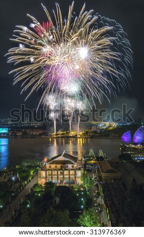 The beauty of the fireworks on the banks of the Saigon River, fireworks with many different shapes are honoring a beautiful sky - stock photo