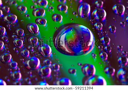 The beauty of water droplets in a rainbow - stock photo