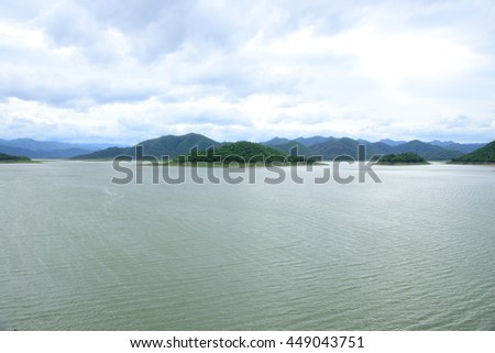 The beauty of water in the dam with a backdrop as he was surrounded. - stock photo