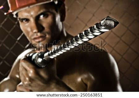 the beauty worker driller man  close up, wield with  perforator - stock photo