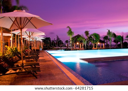 the  bed beside the pool facing to the sea for the romantic time, in Phu Quoc - vietnam - stock photo