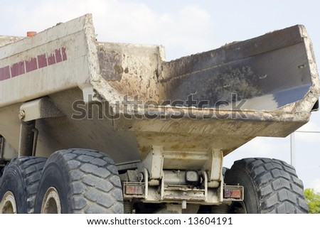 The bed of a heavy duty dump truck - stock photo