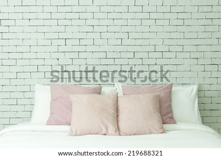 The bed on white bricks wall background - stock photo