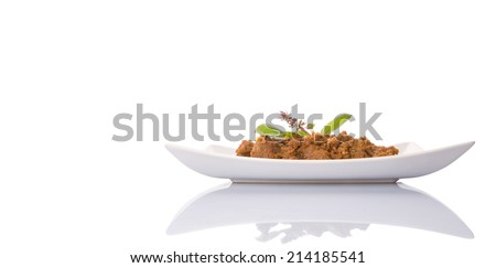 The Beef Rendang, a popular traditional Malay dish on white plate over white background - stock photo