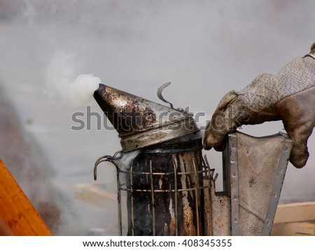 The beekeepers collect honey by the bees. - stock photo