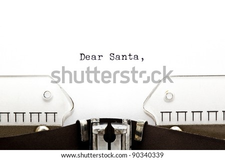 The beginning of a letter to Santa written on an old typewriter. - stock photo
