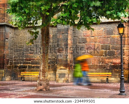 the beginning of autumn, rainy day, walking couple under umbrella on the background of the old wall, with green maple leaves, a beautiful city lights