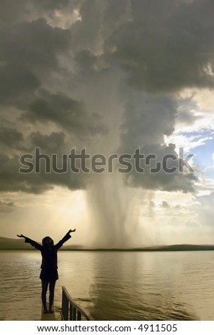 the beginning of the tornado and girl silhouette - stock photo
