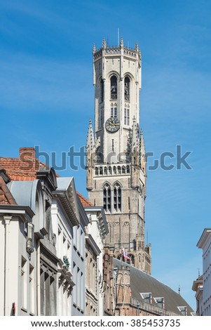 The Belfry Tower of Bruges or Belfort in sunny day, is medieval bell tower in the historical centre of Bruges, Belgium - stock photo