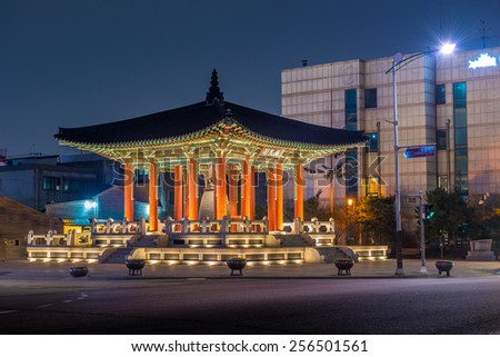 The bell pavilion of Hwaseong Fortress lit up as evening comes on.